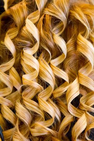 hair stylist: Curly hair detail on a wedding day by a hair stylist.
