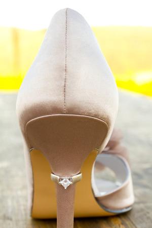 stilletto: Wedding ring of the bride on a stilletto high heel shoe.