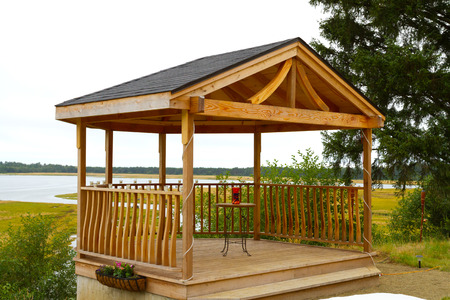 Wooden gazebo custom built on a property with a view.