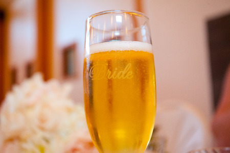 etched: Flute of champagne with the word bride etched in it.
