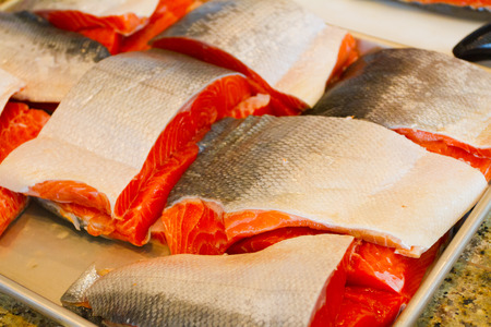 filets: Feshly caught salmon fish filets ready to be cooked.