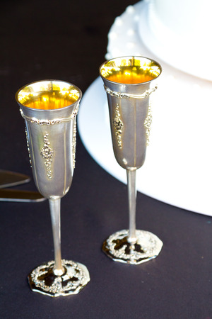 champagne flute: Champagne flute at a wedding reception ready for a toast.