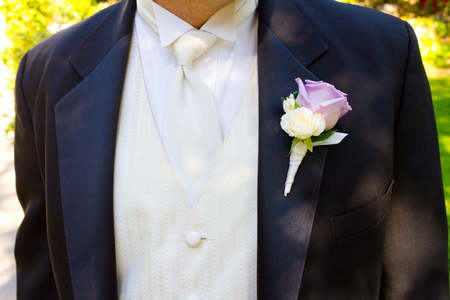 attire: Wedding attire worn by the groom on his big day.