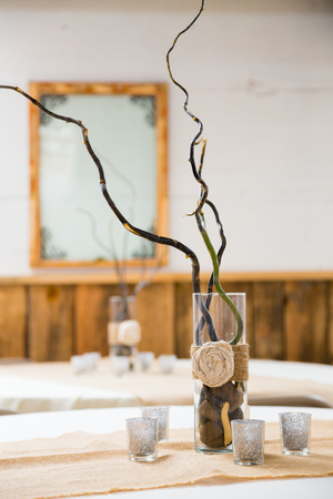 centerpiece: Centerpiece on a table at a wedding reception with burlap country decor.