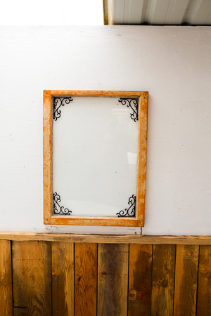 wedding decor: Wedding decor includes this picture frame mirror in a barn.