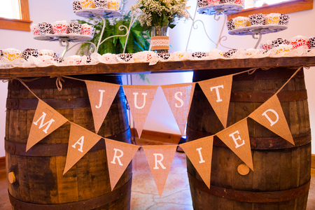 decor: Just married sign made out of burlap flags at an Oregon wedding ceremony and reception.