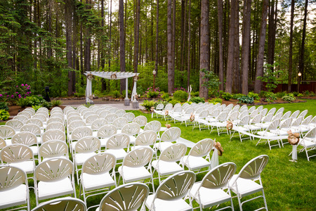 wedding day: Wedding venue in Oregon has natural trees and beautiful guest seating amidst tall trees.