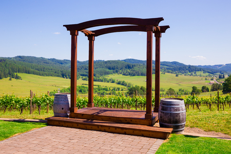 venue: Wedding venue in Western Oregon at a winery with outdoor seating overlooking the vineyard. Stock Photo
