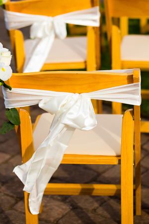 venue: Chairs at this wedding venue are made of wood and look like nice elegant seating for guests.