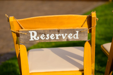 reserved seat: Reserved seating for family at an outdoor wedding ceremony. Stock Photo