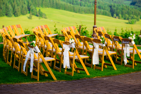 Chairs at this wedding venue are made of wood and look like nice elegant seating for guests.