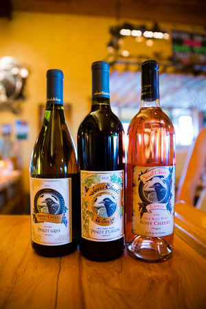 the cheeks: LORANE, OR - MAY 31, 2014: Wine selection featuring three wines at Sweet Cheeks Winery in Oregon.