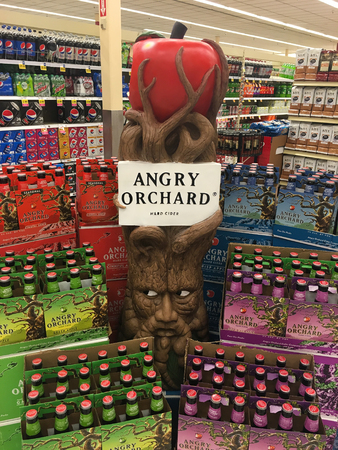 SPRINGFIELD, OR - OCTOBER 22, 2015: Angry Orchard hard apple cider tower display on the endcap of an aisle at a grocery store.