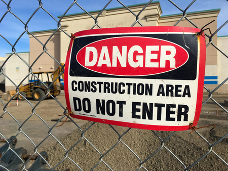 SPRINGFIELD, OR - OCTOBER 22, 2015: Danger sign on fence at the Gateway Mall renovation construction site.