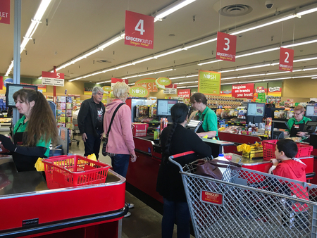 line: SPRINGFIELD, OR - OCTOBER 22, 2015: Shoppers in line at checkout stands at Grocery Outlet, a bargain liquidation market.