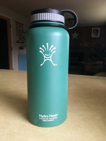 SPRINGFIELD, OR - OCTOBER 23, 2015: Insulated Hydro Flask water bottle in green on a kitchen counter.