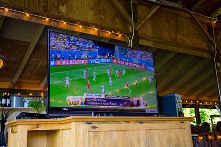 SPRINGFIELD, OR - JULY 5, 2014: 2014 FIFA World Cup Brazil soccer quarterfinal broadcast on a flatscreen tv at a bar.