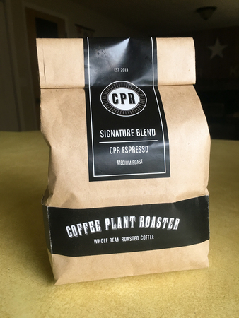 SPRINGFIELD, OR - OCTOBER 23, 2015: Signature espresso blend of coffee roasted and packaed by Coffee Plant Roaster in Eugene Oregon.