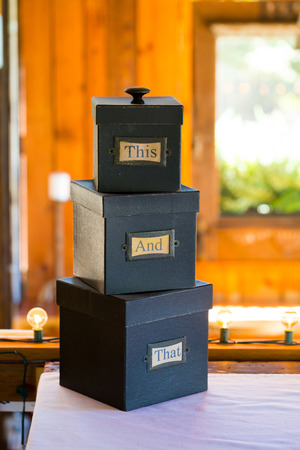 this: Wedding decorations for a diy reception with boxes that say this and that.