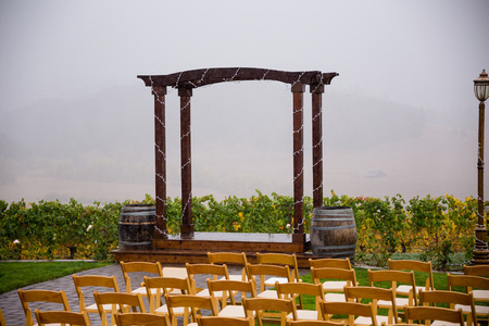 venue: Wedding venue with ceremony seating in the middle of a rain storm. Stock Photo