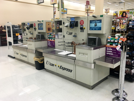 checkout: SPRINGFIELD, OR - OCTOBER 28, 2015: U-Scan Express Self Checkout scanner machine at a grocery store supermarket. Editorial