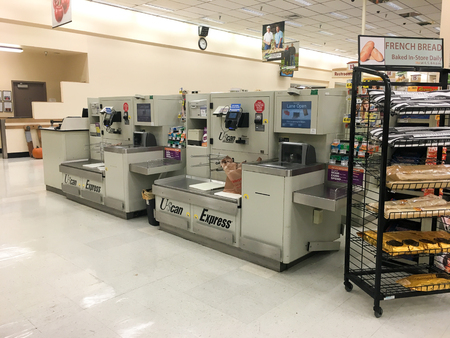 SPRINGFIELD, OR - OCTOBER 28, 2015: U-Scan Express Self Checkout scanner machine at a grocery store supermarket. Editorial