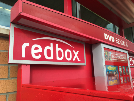 rentals: SPRINGFIELD, OR - OCTOBER 28, 2015: Redbox movie rental machines in front of a supermarket grocery store.