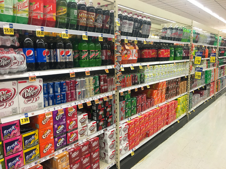 soda pop: SPRINGFIELD, OR - OCTOBER 28, 2015: Grocery store selection of soda pop on shelves.