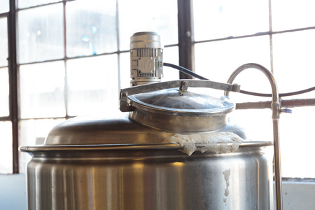eugene: EUGENE, OR - NOVEMBER 4, 2015: Boiling mash for an IPA beer at the startup craft brewery Mancave Brewing.