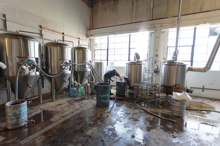 eugene: EUGENE, OR - NOVEMBER 4, 2015: Brewery owner Wes Gunderson brewing an IPA at the startup craft brewery Mancave Brewing.