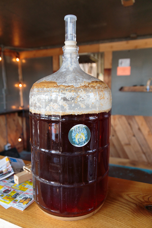 fermenting: EUGENE, OR - NOVEMBER 4, 2015: Five gallon homebrew beer fermenting at the startup craft brewery Mancave Brewing.