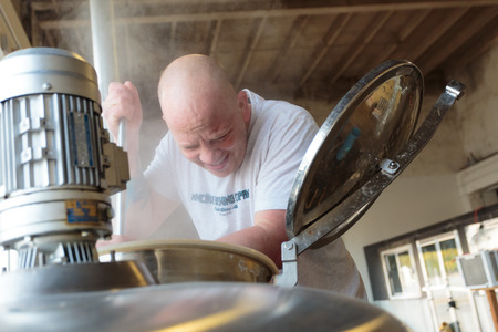 eugene: EUGENE, OR - NOVEMBER 4, 2015: Head brewmaster Brandon Woodruff brewing an IPA at the startup craft brewery Mancave Brewing.