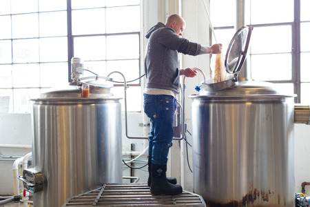 woodruff: EUGENE, OR - NOVEMBER 4, 2015: Head brewmaster Brandon Woodruff commercially brewing an IPA at the startup craft brewery Mancave Brewing. Editorial