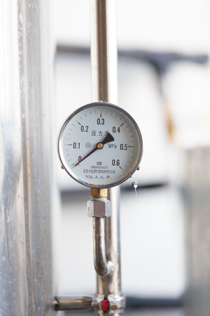 brewery: EUGENE, OR - NOVEMBER 4, 2015: Pressure valve on a fermenter at the startup craft brewery Mancave Brewing.