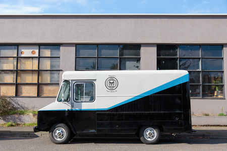 brewery: EUGENE, OR - NOVEMBER 4, 2015: Beer delivery van at the startup craft brewery Mancave Brewing. Editorial