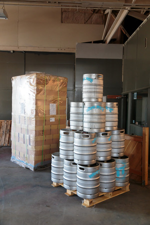 brewery: EUGENE, OR - NOVEMBER 4, 2015: Stainless steel beer kegs stacked together at the startup craft brewery Mancave Brewing.