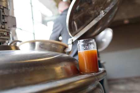 eugene: EUGENE, OR - NOVEMBER 4, 2015: Exalted IPA on a fermenter at the startup craft brewery Mancave Brewing.