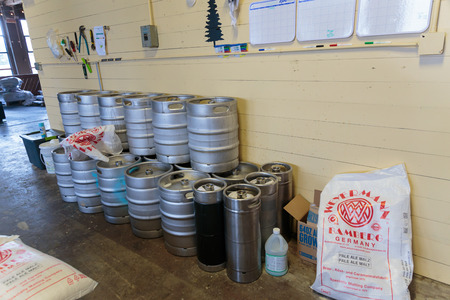 eugene: EUGENE, OR - NOVEMBER 4, 2015: Stainless steel beer kegs stacked together at the startup craft brewery Mancave Brewing.