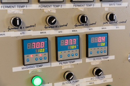 fermenters: EUGENE, OR - NOVEMBER 4, 2015: Electrical control panel for temperature control of fermenters and mashing machines at the startup craft brewery Mancave Brewing.