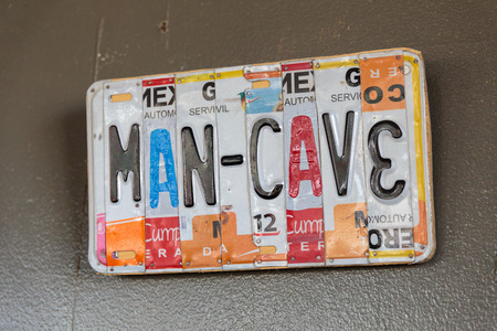 license plate: EUGENE, OR - NOVEMBER 4, 2015: License plate logo sign at the startup craft brewery Mancave Brewing.