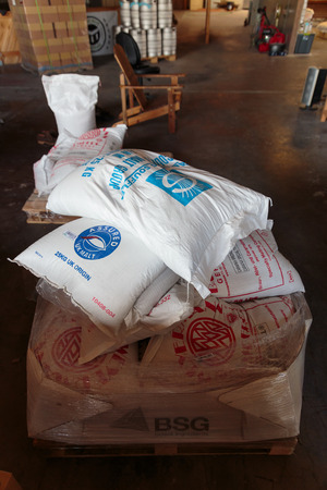 EUGENE, OR - NOVEMBER 4, 2015: German pale ale malt in bulk bags from a large shipment at the startup craft brewery Mancave Brewing. Redakční