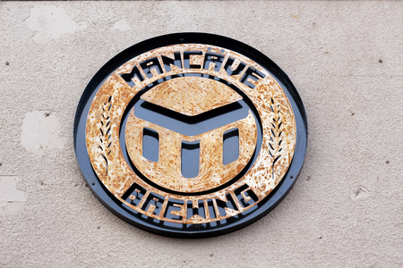 eugene: EUGENE, OR - NOVEMBER 4, 2015: Company logo on the outside of a building at the startup craft brewery Mancave Brewing. Editorial