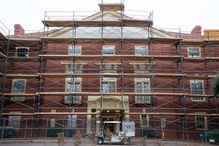 EUGENE, OR - OCTOBER 27, 2015: Gerlinger Hall on the University of Oregon campus undergoes major renovations and brick repair on the exterior of the building.