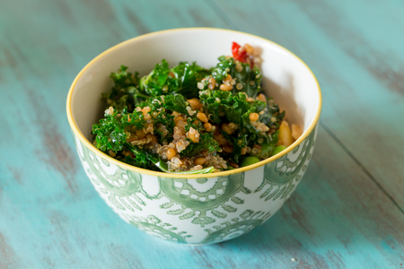 Barley: Superfood salad with raw kale, quinoa, blueberries, and barley is perfect for the paleo diet for weight loss. Stock Photo