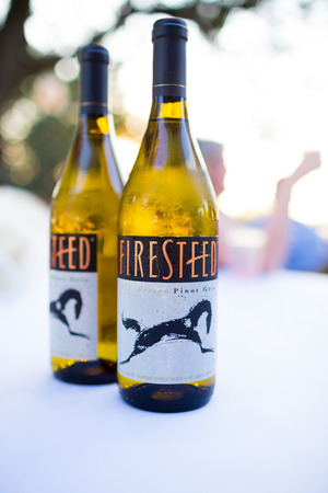 pinot: HARRISBURG, OR - JULY 12, 2014: Firesteed Pinot Gris white wine on a table at a wedding reception.
