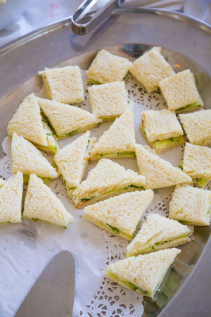 chicken salad: Chicken salad sandwiches at a wedding reception on a fancy platter.