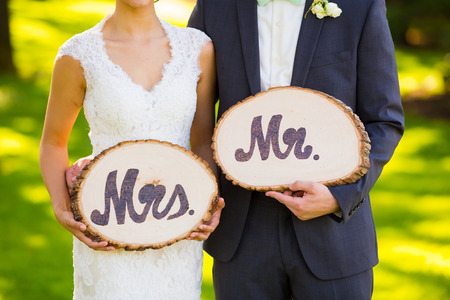 Mr and Mrs signs for the bride and groom used for decor at this wedding ceremony and reception Imagens