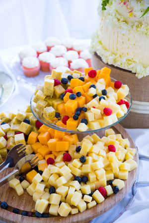 Cheese plate or platter at a wedding reception with traditional cheese cubes.