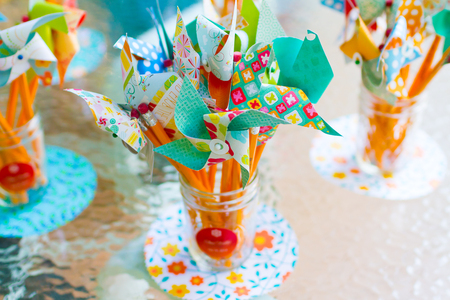 pinwheels: Pinwheels in a jar at a wedding reception made from colorful fabric and paper.