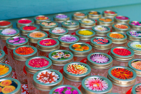Mason jars covered with colorful fabric at a wedding reception. Stock fotó